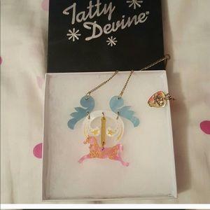 Tatty Divine